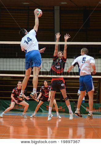 KAPOSVAR, HUNGARY - MARCH 6: Krisztian Csoma (C) blocks the ball at a Hungarian National Championship volleyball game Kaposvar vs. Kazincbarcika, March 6, 2011 in Kaposvar, Hungary.