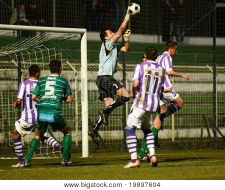 KAPOSVAR, HUNGARY - MARCH 16: Szabolcs Balajcza (with the ball) in action at a Hungarian National Cup soccer game - Kaposvar vs Ujpest on March 16, 2011 in Kaposvar, Hungary.