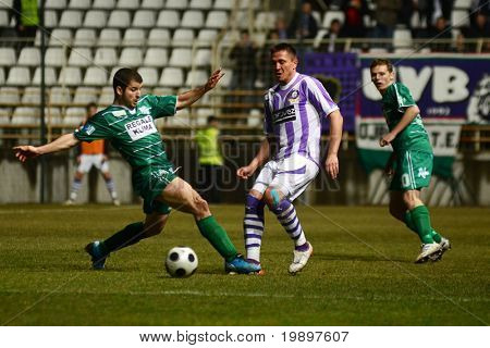 KAPOSVAR, HUNGARY - MARCH 16: Pedro Sass (L) in action at a Hungarian National Cup soccer game - Kaposvar vs Ujpest on March 16, 2011 in Kaposvar, Hungary.
