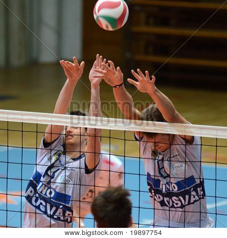 KAPOSVAR, HUNGARY - MARCH 18: Krisztian Csoma (L) blocks the ball at a Hungarian National Championship volleyball game Kaposvar vs. Csepel, March 18, 2011 in Kaposvar, Hungary.