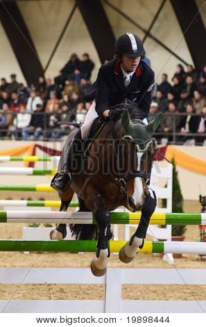 KAPOSVAR, HUNGARY - MARCH 27: Barna Burucs jumps with his horse (Prima) on the Masters Tournament International Jumping Competition, March 27, 2011 in Kaposvar, Hungary