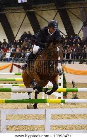KAPOSVAR, HUNGARY - MARCH 27: Atttila Cser jumps with his horse (Laura) on the Masters Tournament International Jumping Competition, March 27, 2011 in Kaposvar, Hungary