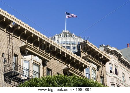 Usa Flag On Top Of A Building