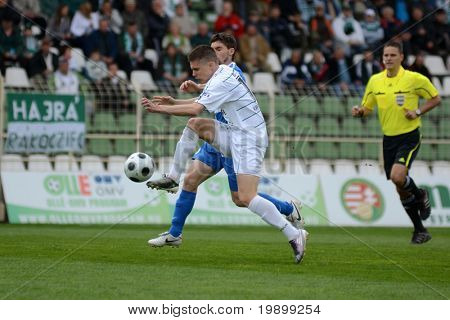 KAPOSVAR, HUNGARY - APRIL 16: Benjamin Balazs (in white) in action at a Hungarian National Championship soccer game - Kaposvar vs MTK Budapest on April 16, 2011 in Kaposvar, Hungary.