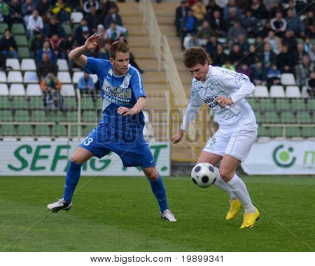 KAPOSVAR, HUNGARY - APRIL 16: Milan Peric (R) in action at a Hungarian National Championship soccer game - Kaposvar vs MTK Budapest on April 16, 2011 in Kaposvar, Hungary.