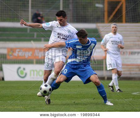 KAPOSVAR, HUNGARY - APRIL 16: Patrik Tischler (in blue) in action at a Hungarian National Championship soccer game - Kaposvar vs MTK Budapest on April 16, 2011 in Kaposvar, Hungary.