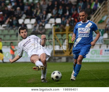 KAPOSVAR, HUNGARY - APRIL 16: Pedro Sass (in white) in action at a Hungarian National Championship soccer game - Kaposvar vs MTK Budapest on April 16, 2011 in Kaposvar, Hungary.