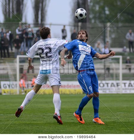 KAPOSVAR, HUNGARY - APRIL 16: Bojan Pavlovic (in white) in action at a Hungarian National Championship soccer game - Kaposvar vs MTK Budapest on April 16, 2011 in Kaposvar, Hungary.