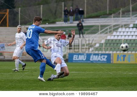 KAPOSVAR, HUNGARY - APRIL 16: Istvan Bank (R) in action at a Hungarian National Championship soccer game - Kaposvar vs MTK Budapest on April 16, 2011 in Kaposvar, Hungary.