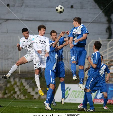 KAPOSVAR, HUNGARY - APRIL 16: Unidentified players in action at a Hungarian National Championship soccer game - Kaposvar vs MTK Budapest on April 16, 2011 in Kaposvar, Hungary.