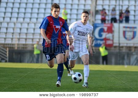 KAPOSVAR, HUNGARY - APRIL 27: Pal Lazar (L) in action at a Hungarian National Cup soccer game Kaposvar vs Videoton April 27, 2011 in Kaposvar, Hungary.