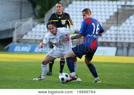 KAPOSVAR, HUNGARY - APRIL 27: Lorant Olah (in white) in action at a Hungarian National Cup soccer game Kaposvar vs Videoton April 27, 2011 in Kaposvar, Hungary.