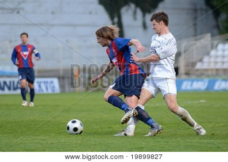 KAPOSVAR, HUNGARY - APRIL 20: Attila Polonkai (L) in action at a Hungarian National Cup soccer game Kaposvar vs Videoton April 20, 2011 in Kaposvar, Hungary.
