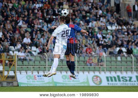 KAPOSVAR, HUNGARY - APRIL 20: Nikolic Nemanja (R) in action at a Hungarian National Cup soccer game Kaposvar vs Videoton April 20, 2011 in Kaposvar, Hungary.