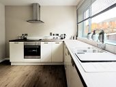 picture of rebuilt  - colour image kitchen in newly restored rebuilt house work surfaces - JPG