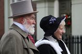 ROCHESTER CITY, KENT, ENGLAND - DEC 11: Couple play Dickens characters at annual Rochester Dickens F