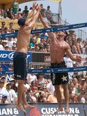 HERMOSA BEACH, CA. - AUGUST 9: Phil Dalhausser (L) and Todd Rogers vs. John Hyden and Sean Scott (R)