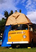 foto of camper-van  - A beautiful european vintage camper van with tent - JPG