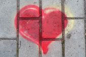 picture of graff  - Red heart is painted on the ground - JPG