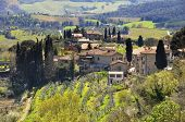 stock photo of farmworker  - Small village in Tuscany - JPG