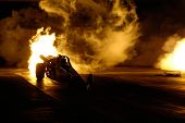 CHANDLER, AZ - APRIL 25: A jet powered drag car ignites its engine at the Firebird International Rac