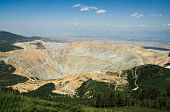 stock photo of open-pit mine  - A more than two mile wide open pit mine seen from above - JPG