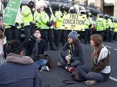 LONDON - DEC 9: Students demonstration against university fee rises in front of police lines at the