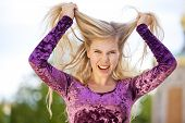 angry fashion model tearing her hair