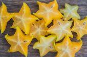 Star Fruits On Wooden Table. Thai Fruit : Star Fruit Is Popular In Asia, Sweet Taste Fruits. Star Fr poster