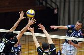 KAPOSVAR, HUNGARY - APRIL 7: Sandor Kantor (R) stirkes the ball at a friendly volleyball game Kaposv
