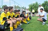 KAPOSVAR, HUNGARY - JULY 19: The Cyprian players listen to their trainer at a VI. Youth Football Fes