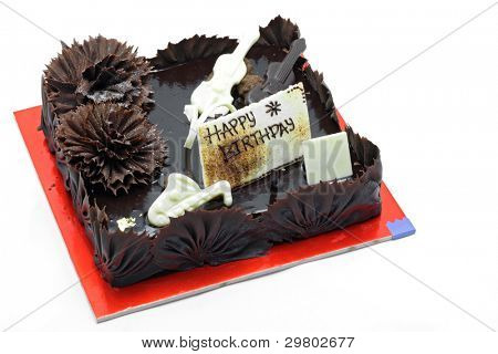 Whole Dark and Sweet Chocolate Happy Bitrthday Cake Dessert isolated on White Background, Top View.