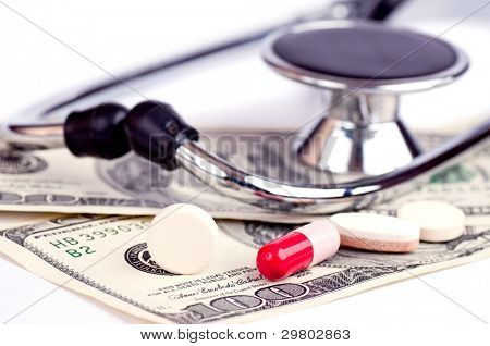 Medicines and stethoscope on the hundred-Dollars  bills