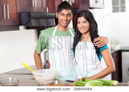modern young  indian couple in kitchen