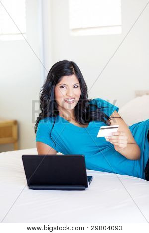beautiful young woman shopping online with credit card