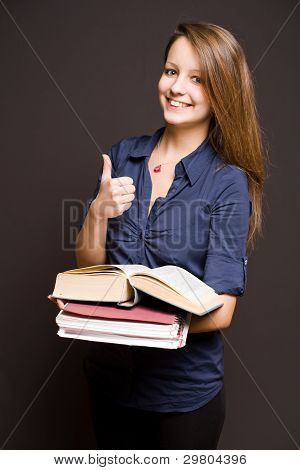 Cute Student Showing Thumbs Up.