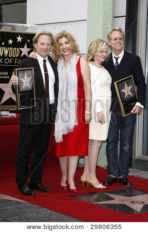 LOS ANGELES - FEB 6: Dewey Bunnell; wife Penny; Gerry Beckley; wife Kathy at a ceremony where their rock band 'America' in honored with a star on the Hollywood Walk of Fame in Los Angeles, California. Feb 6, 2012