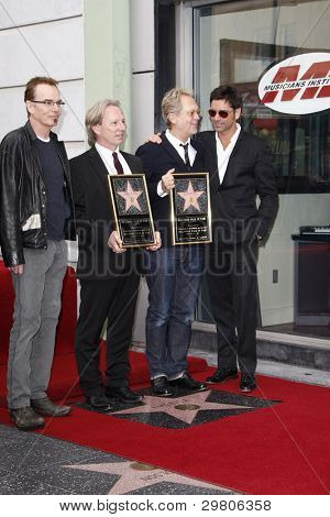 LOS ANGELES - FEB 6: Billy Bob Thornton; Gerry Beckley; Dewey Bunnell; John Stamos at a ceremony where their rock band 'America' in honored with a star on the Hollywood Walk of Fame in Los Angeles, CA. Feb 6, 2012