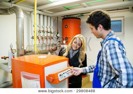 young engineers in heating boiler heating system with