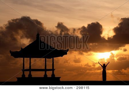 Woman Raising Her Hands At Sunrise