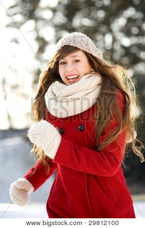 Woman running in winter scene