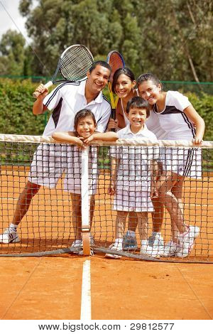 Group of tennis players of all ages at the court