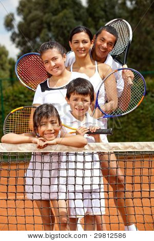 Five member family at the tennis court