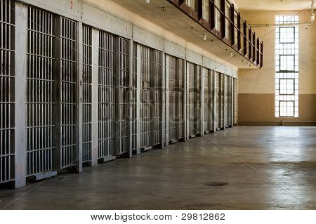 Jail Cells Lined Up Against The Wall