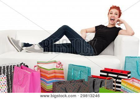 Happy Shopper Surrounded With Bags