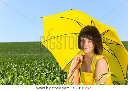 Young  Girl With Yellow Umbrella .