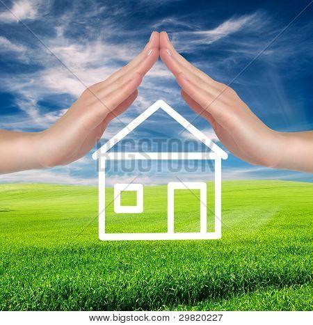 Campo verde sobre céu azul nublado com mão feminino branco desenhado House