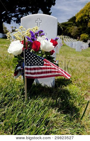 Headstone And American Flag At National Cemetery