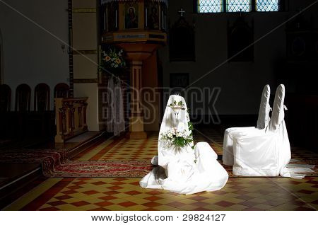 Chairs in the church for the wedding ceremony.