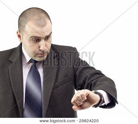 Surprised Business Man Consulting His Watch
